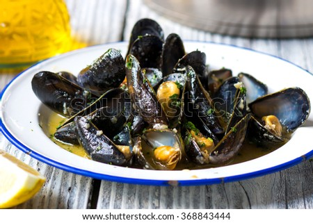 Steamed mussels in wine sauce  - stock photo