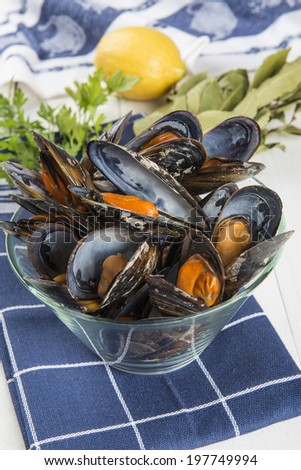 Steamed mussels with lemon ready to be eaten - stock photo