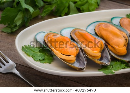 Steamed mussels with parsley on plate  - stock photo