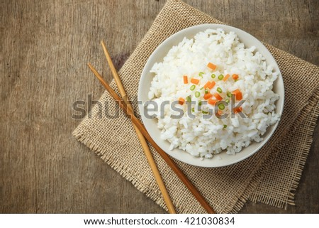 Steamed rice close-up with chopsticks on burlap - stock photo