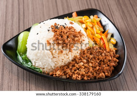 Steamed Rice with Red-Cooked Pork,Chinese fast food - stock photo
