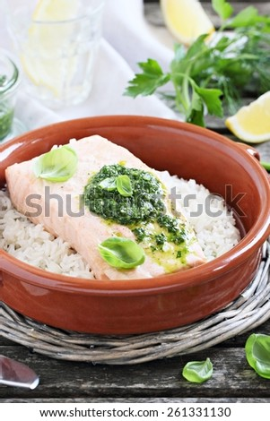 Steamed salmon with pesto and rice garnish.Healthy eating.Selective focus. - stock photo