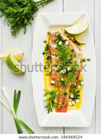 Steamed sea bass with fennel and leek in olive and linseed oil. Viewed from above. - stock photo