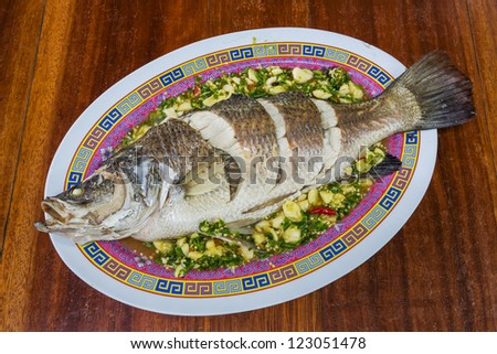 Steamed sea bass with lemon, chili and garlic sauce