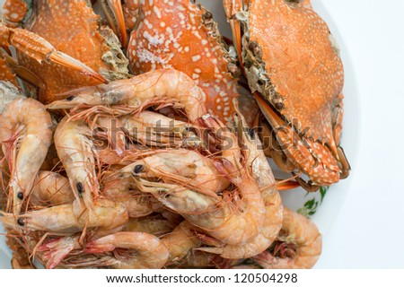 Steamed sea food in white plate. - stock photo