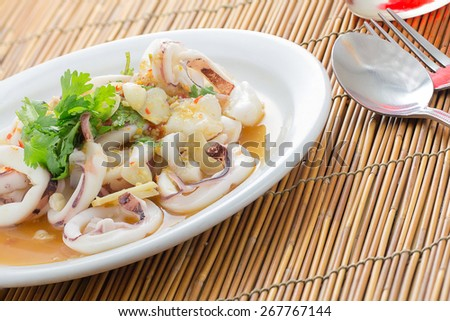 steamed Squid in white dish - stock photo