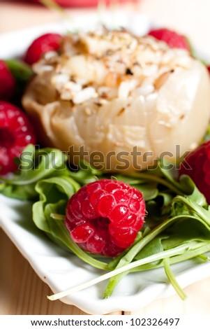 steamed stuffed onions with arugula and raspberry