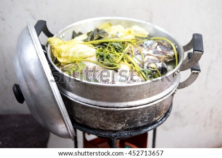 Steamed Tilapia with vegetable in pot ,Thai food