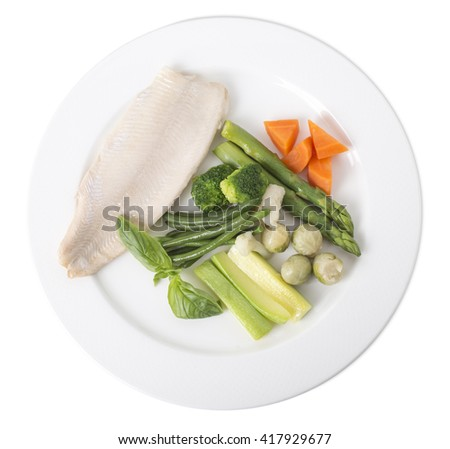 Steamed trout fillet with vegetables. Isolated on a white background.