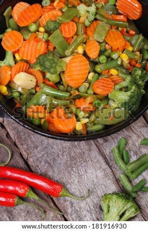 steamed vegetables in the pan. vertical. close up. top view  - stock photo