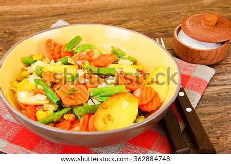 Steamed vegetables potatoes, carrots, corn, green beans, onion Studio Photo - stock photo