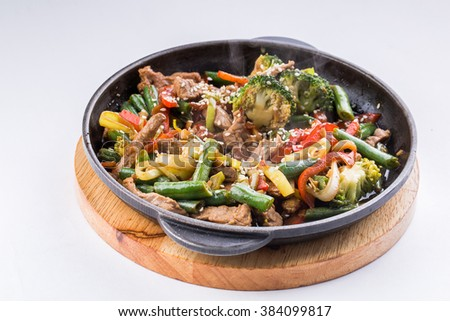 Steamed Vegetables Potatoes, Carrots, Corn, Green Beans, Onion with meat. white background