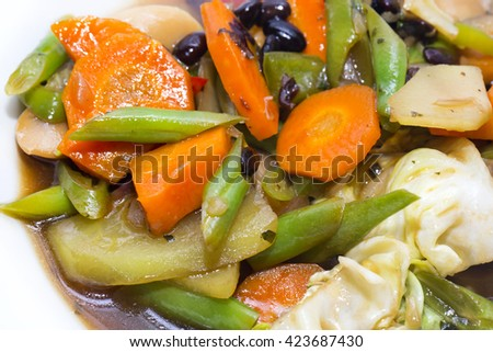 steamed vegetables with soy sauce on a white background in the restaurant - stock photo
