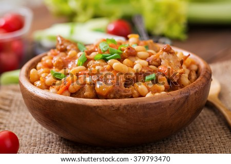 Steamed white beans with meat in tomato sauce - stock photo