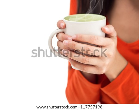 Steaming coffee cup. Woman holding hot cup with two hands. Isolated on white copy space. - stock photo