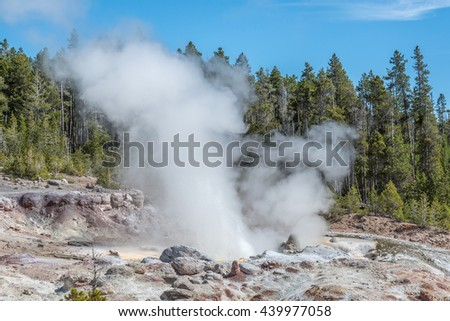Steaming geyser in Yellowstone National Park - stock photo