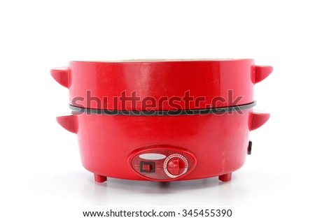 steaming old electric pot for steam cooking and frying food the pot isolated on white - stock photo