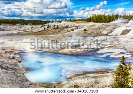 Steaming opaque thermal pools at Norris Geyser Basin. Yellowstone National Park, Wyoming - USA - stock photo