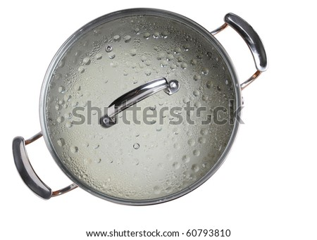 steaming pot on a burner isolated on white background. Steam Condensing on Glass Pot lid - stock photo