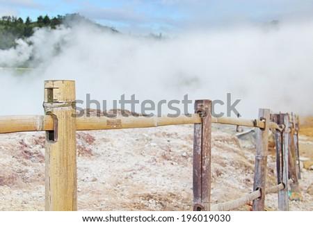 steaming volcanic krator - stock photo