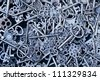 steampunk background within a lot of steel keys - stock photo