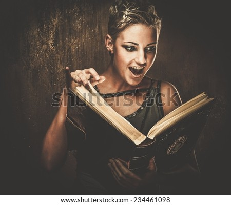 Steampunk girl with a book - stock photo