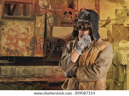 Steampunk man wearing glasses. Post-apocalypse fantasy