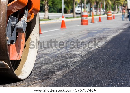 Steamroller during road construction. Asphalt pavement works  - stock photo