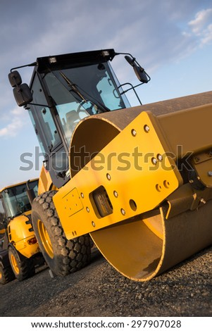 steamroller on a construction site - stock photo
