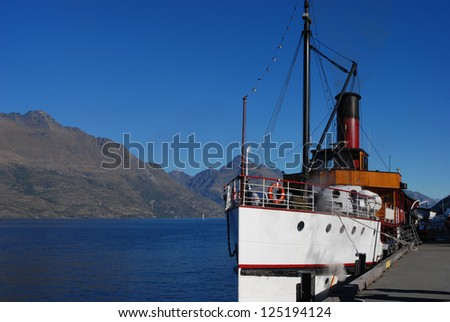 Steamship on lake near Queenstown in New Zealand - stock photo