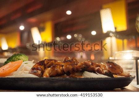 Steamy japanese chicken teriyaki plate with vegetables.
