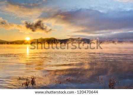 Steamy lake Sunrise - stock photo