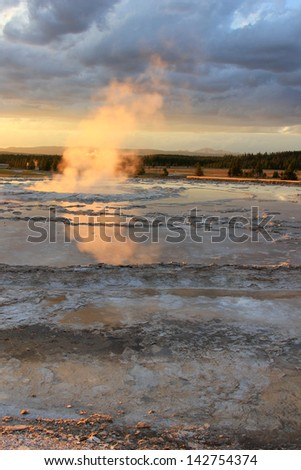 Steamy reflection at a hot spring in Yellowstone National Park, Wyoming, USA. - stock photo