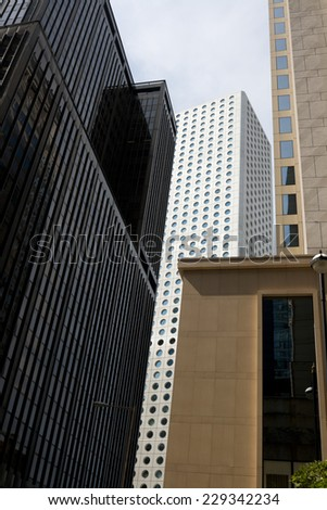 Steel and glass skyscrapers in Central business district of Hong Kong, China - stock photo