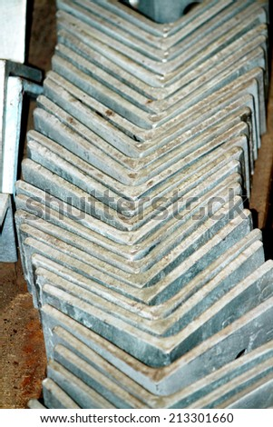 Steel angles bunch in the wooden pallet in wartehouse - stock photo