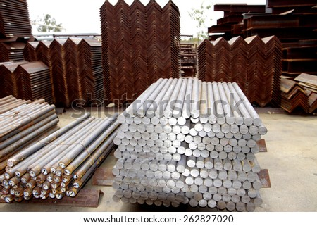 Steel bars bunch on the rack in warehouse - stock photo
