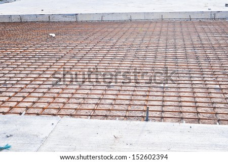 Steel bars mesh reinforcement before pouring concrete - stock photo