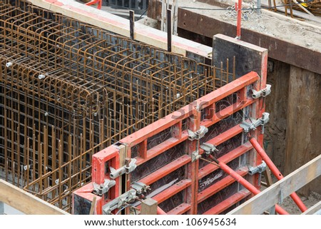 Steel bars ready for reinforced concrete foundation - stock photo