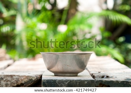 Steel bowl on wooden table.