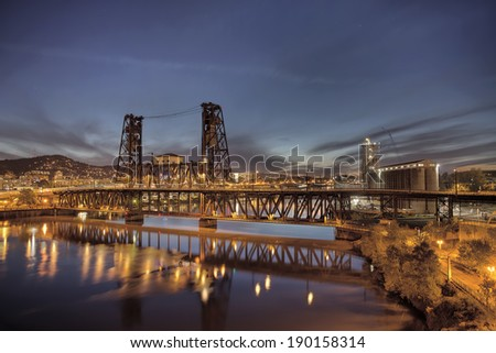 Steel Bridge with Broadway and Fremont Bridges Over Willamette River at Evening Blue Hour in Portland Oregon - stock photo