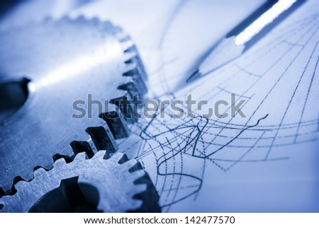 Steel cogwheels in connection on drawing - stock photo