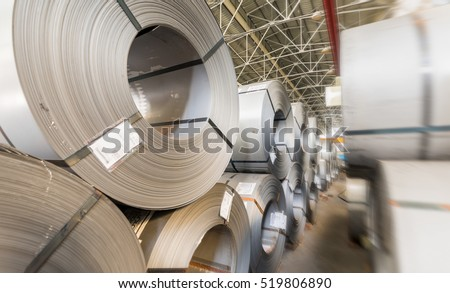 Steel coils stacked in a warehouse.