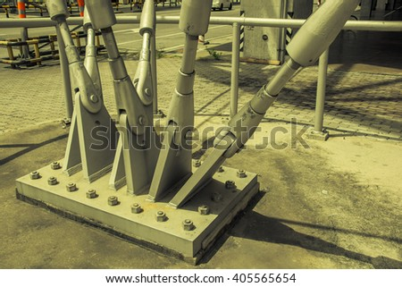 Steel column support with bolts and nuts.vintage tone - stock photo