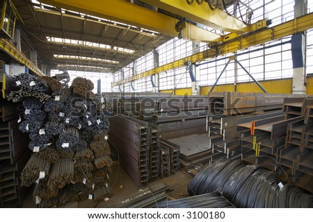 steel components in a warehouse - stock photo