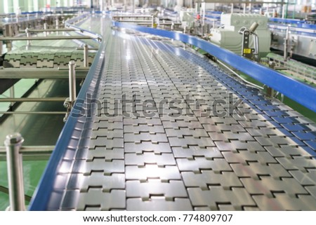 Steel conveyor for transportation of glass bottles. Belt and roller conveyors.