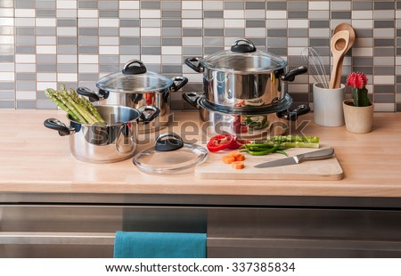 steel cookware set with modern kitchen - stock photo