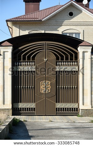 Steel   decorative  gates. The characteristic structure of the North Caucasus. - stock photo