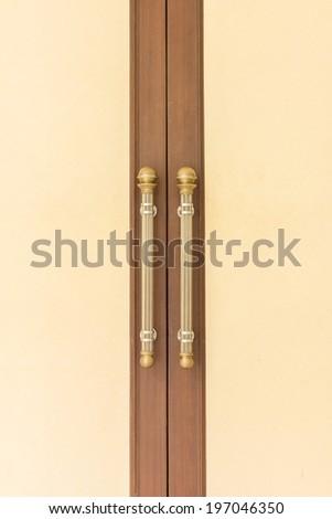 Steel Door handles on Vintage Wood Door - stock photo