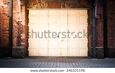 steel Door in a red brick wall background - stock photo