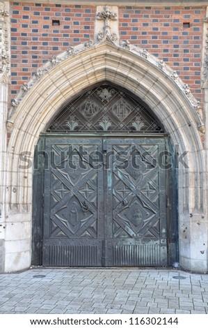 Steel door with decorative portal - stock photo